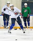 John Carlson (USA - 11) - Team USA practiced at the Agriplace rink on Monday, December 28, 2009, in Saskatoon, Saskatchewan, during the 2010 World Juniors tournament.