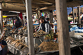 INDONESIA, Flores, a young Muslim woman sells dried fish at the Aimere Market in Aimere