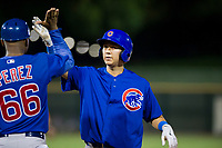 AZL Cubs designated hitter Kwang-Min Kwon (27) receives a high five from assistant hitting coach Leonel Perez (66) during a game against the AZL Giants on September 5, 2017 at Scottsdale Stadium in Scottsdale, Arizona. AZL Cubs defeated the AZL Giants 10-4 to take a 1-0 lead in the Arizona League Championship Series. (Zachary Lucy/Four Seam Images)
