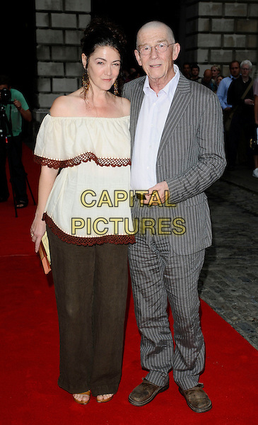 GUEST &amp; JOHN HURT <br /> At the &quot;Hellboy II: The Golden Army &quot; FilmFour Summer Screen Opening Gala, Somerset House,<br /> London, England, July 31st 2008.<br /> 2 screening premiere full length white off the shoulder top grey gray suit shirt  pinstripe<br /> CAP/CAN<br /> &copy;Can Nguyen/Capital Pictures