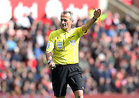 Referee Martin Atkinson during the Barclays Premier League match between Stoke City and Swansea City played at Britannia Stadium, Stoke on April 2nd 2016