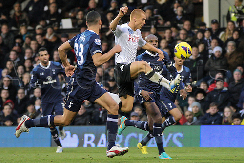01.12.2012 London, England.  Steve SIDWELL of Fulham wins the ball under presure from Steven CAULKER (33) and French international William GALLAS of Spurs during the Barclays Premier League match between Fulham and Tottenham Hotspur at Craven Cottage.