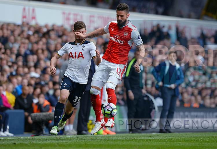Olivier Giroud of Arsenal is challenged by Ben Davies of Tottenham Hotspur during the English Premier League match at the White Hart Lane Stadium, London. Picture date: April 30th, 2017.Pic credit should read: Robin Parker/Sportimage
