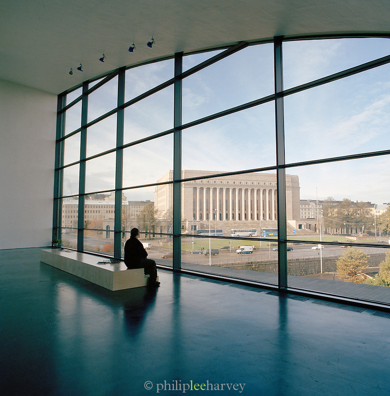 Man sitting by the window in Helsinki's museum of modern art