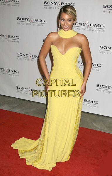 BEYONCE KNOWLES.Sony BMG 2008 Grammy Awards After-Party held at the Beverly Hills Hotel Photo, Beverly Hills, California, USA..February 10th, 2008.full length yellow strapless dress neck hands on hips .CAP/ADM/RE.©Russ Elliot/AdMedia/Capital Pictures.
