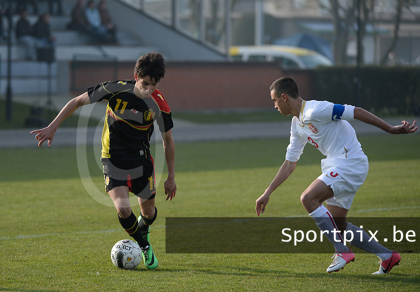 20140314 - HEIST , BELGIUM : Belgian Ismail Azzaoui pictured with Serbian Nikola Dukic (r) during a friendly soccer match between the Under16 soccerteams of Belgium and Serbia , Friday 14 March 2014 in Heist . PHOTO DAVID CATRY