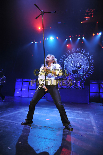 WHITESNAKE - David Coverdale.Whitesnake performing live at the Hammersmith Apollo, London, England..June 20th, 2011.stage concert live gig performance music full length white shirt microphone balance balancing looking up jeans denim black chest.CAP/MAR.© Martin Harris/Capital Pictures.