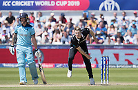 James Neesham (New Zealand) bowls as Ben Stokes (England) backs up during England vs New Zealand, ICC World Cup Cricket at The Riverside Ground on 3rd July 2019