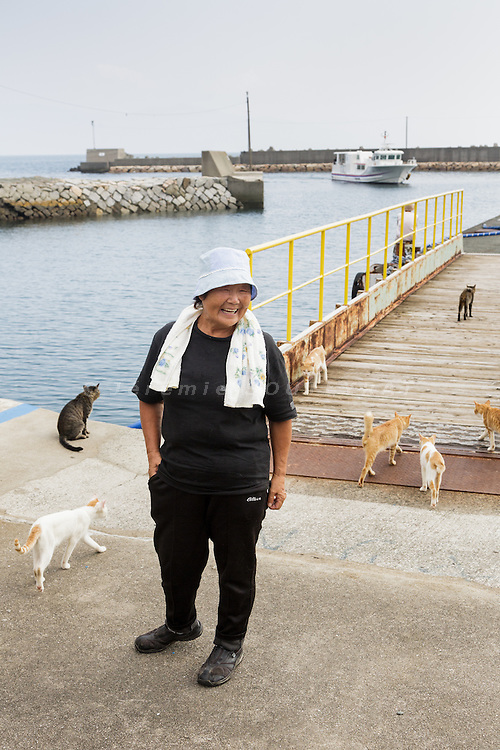 Aoshima, Ehime prefecture, September 4 2015 - Naoko KAMIMOTO is the local person in charge of the cats on the island.<br /> Aoshima (Ao island) is one of the several &laquo; cat islands &raquo; in Japan. Due to the decreasing of its poluation, the island now host about 6 times more cats than residents.