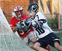 Penn State's Nick Aponte (10) en route to scoring a goal against Ohio State's Matt Borges (32) on April 2, 2017.  No. 2 Penn State defeated No. 5 Ohio State 9-4. Photo/©2017 Craig Houtz