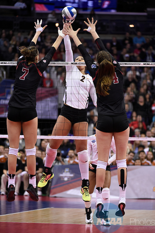 COLUMBUS, OH - DECEMBER 17:  Ebony Nwanebu (2) of the University of Texas attempts a kill against Ivana Vanjak (7) and Audriana Fitzmorris (24) of Stanford University during the Division I Women's Volleyball Championship held at Nationwide Arena on December 17, 2016 in Columbus, Ohio.  Stanford defeated Texas 3-1 to win the national title. (Photo by Jamie Schwaberow/NCAA Photos via Getty Images)