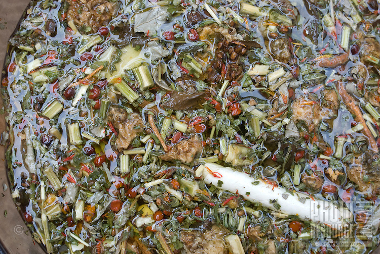 Chinese medicinal herbs soak in a pot of water