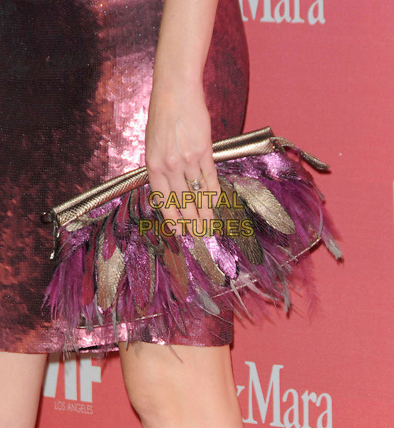 AMBER VALLETTA .at The Women in Film 2009 Crystal .and Lucy Awards held at The Hyatt Regency Century Plaza in Century City, California, USA, June 12th 2009                                                                     .detail feather pink purple bag clutch hand purse feathered feathers ring .CAP/DVS.©Debbie VanStory/RockinExposures/Capital Pictures