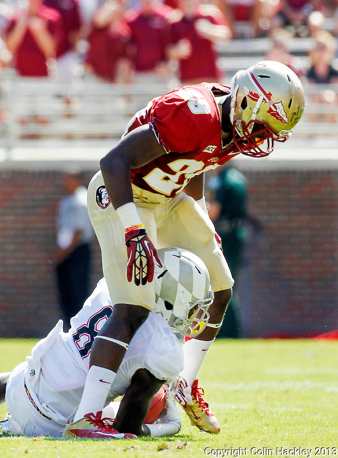 TALLAHASSEE, FLA.10-05-13-FSU-MARY100513CH-Florida State's Nate Andrews looms over Maryland's Levern Jacobs after he and Jalen Ramsey (not pictured) stopped Jacobs during first half action Saturday at Doak Campbell Stadium in Tallahassee. <br /> COLIN HACKLEY PHOTO
