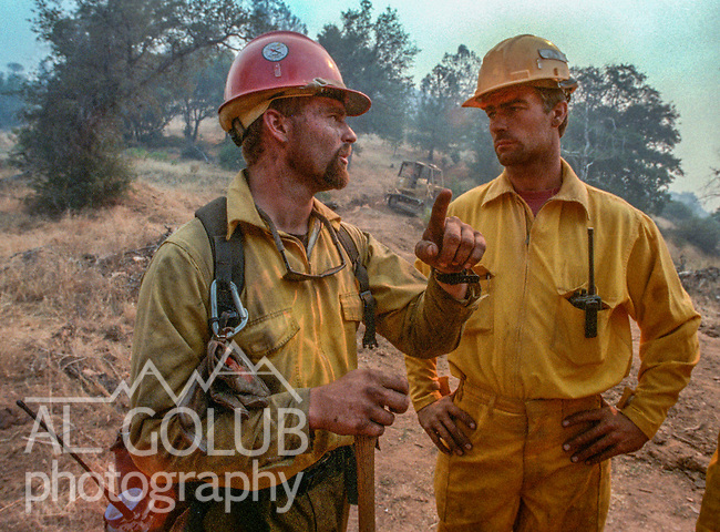 August 16, 1996 Sonora, California  -- Rogge Fire – Stanislaus Hotshot tells dozer driver where to cut fire break. The Ackerson and Rogge Fires combined to char 60,000 acres in 1996. The Rogge Fire was centered on the north side of the Tuolumne River, burning over Jawbone Ridge and Cherry Creek areas.