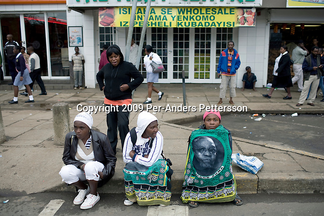 PIETERMARITZBURG, SOUTH AFRICA FEBRUARY 4: Unidentified ANC supporters wait early in the morning for ANC president Jacob Zuma to appear in court on February 4, 2009 in Pietermaritzburg, South Africa. Jacob Zuma appeared in court and a court date was set for August 2009. Mr. Zuma was recently cleared of charges and he is expected to win the general election on April 22, and become South Africa's third democratic president. (Photo by Per-Anders Pettersson)..