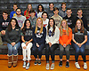 Eighteen senior student-athletes from Mt. Sinai High School donning attire from the colleges of their respective commitments pose for a group portrait in the school's gym on Wednesday, Nov. 8, 2017. Appearing are, FRONT ROW, FROM LEFT: Sienna Masullo - Pace women's lacrosse, Meaghan Scutaro - Notre Dame women's lacrosse, Camryn Harloff - Stony Brook women's lacrosse, Kirsten Scutaro - Notre Dame women's lacrosse, Meaghan Tyrrell - Syracuse women's lacrosse and Emily Seiter - Jacksonville women's lacrosse. MIDDLE ROW, FROM LEFT: Jared Donnelly - NJIT baseball, Jake Croston - Scranton wrestling, Matthew Sageder - Jacksonville men's lacrosse, Joseph Pirecca - Marist men's lacrosse, Michael Hagenberger - Lehigh men's lacrosse, Ethan Angress - City College of New York baseball and Ryan Picarello - Adelphi baseball. BACK ROW, FROM LEFT: Nicholas Bongiorno - Johnson & Wales men's tennis, Emma Wimmer - Queens College softball, Lové Drumgole - Albany softball, Colin McCarthy - Maritime football and Matthew Ventarola - Maritime football.