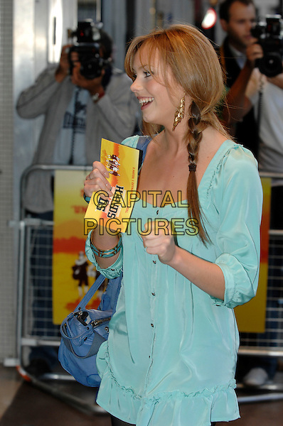 "HANNAH TOINTON.""In the Hands of the Gods"" World Charity Film Premiere.Odeon West End Cinema, Leicester Square, London, England, 10th September 2007 .half length gold earrings hanna plait hair braid green shirt dress tunic top blue bag.CAP/PL.©Phil Loftus/Capital Pictures"