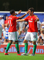 FAO SPORTS PICTURE DESK<br /> Pictured L-R: Scott Sinclair of Swansea celebrating his goal with team mate Danny Graham. Saturday 18 August 2012<br /> Re: Barclay's Premier League, Queens Park Rangers v Swansea City FC at Loftus Road Stadium, London, UK.