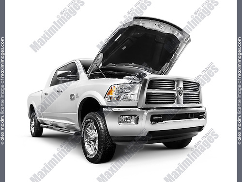 White 2012 Dodge RAM 1500 Laramie Longhorn pickup truck isolated on white background with clipping path