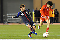 Keigo Higashi (JPN), Hassan Jameel Abdqaheri (BRN), MARCH 14, 2012 - Football / Soccer : 2012 London Olympics Asian Qualifiers Final Round Group C match between U-23 Japan 2-0 U-23 Bahrain at National Stadium in Tokyo, Japan. (Photo by Takamoto Tokuhara/AFLO)