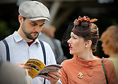 10th September 2017, Goodwood Estate, Chichester, England; Goodwood Revival Race Meeting; Spectators take a look at the Race Programme
