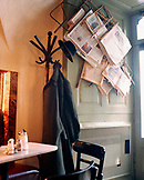 AUSTRIA, Vienna, interior of Kleines Cafe with table, chair, coat and newspapers