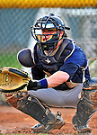 19 July 2010: Staten Island Yankees catcher Nick McCoy warms up a pitcher prior to a game against the Vermont Lake Monsters at Centennial Field in Burlington, Vermont. The game was rained out. Mandatory Credit: Ed Wolfstein Photo