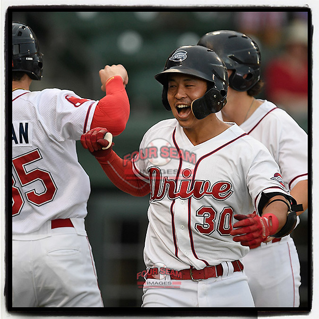 Third baseman Tanner Nishioka (30) of the Greenville Drive is congratulated after hitting a three-run home run in a game against the Lexington Legends on Sunday, September 2, 2018, at Fluor Field at the West End in Greenville, South Carolina. Greenville won, 7-4. (Tom Priddy/Four Seam Images)