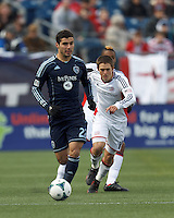 Sporting Kansas City midfielder Soony Saad (22) brings the ball forward.  In a Major League Soccer (MLS) match, Sporting Kansas City (blue) tied the New England Revolution (white), 0-0, at Gillette Stadium on March 23, 2013.