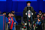 The Rev. Dennis H. Holtschneider, C.M., president of DePaul, left, and Guillermo Vásquez de Velasco, dean of the College of Liberal Arts and Social Sciences, right, listen as Craig W. Hartman, world-renowned architect, addresses the graduating class after receiving his honorary degree Sunday, June 11, 2017, during the DePaul University College of Science and Health and College of Liberal Arts and Social Sciences commencement ceremony at the Allstate Arena in Rosemont, IL. (DePaul University/Jamie Moncrief)