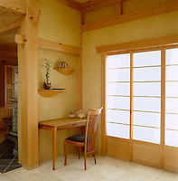 The interior woodwork of a contemporary adobe house in New Mexico shows something of a Japanese influence