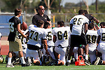 Torrance, CA 09/08/11 - Troy Paolucci (Peninsula #55)\, Luca Sartini (Peninsula #73), Issac Martinez (Peninsula #64), Arinze Anakwenze (Peninsula #25) in action during the North-Peninsula Junior Varsity Football game at North High School in Torrance.