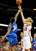 Badgers' Cassie Rochel shoots over Billikens' Kim Bee, as Wisconsin tops Saint Louis 48-46 on Monday night, December 5, 2011, at the Kohl Center in Madison, Wisconsin