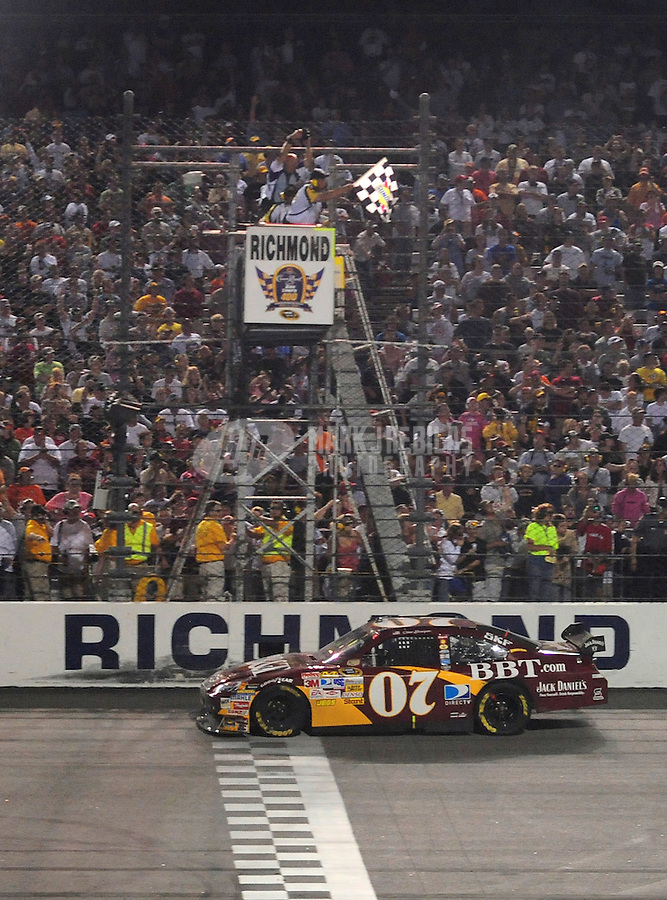 May 3, 2008; Richmond, VA, USA; NASCAR Sprint Cup Series driver Clint Bowyer takes the checkered flag to win the Dan Lowry 400 at the Richmond International Raceway. Mandatory Credit: Mark J. Rebilas-US PRESSWIRE