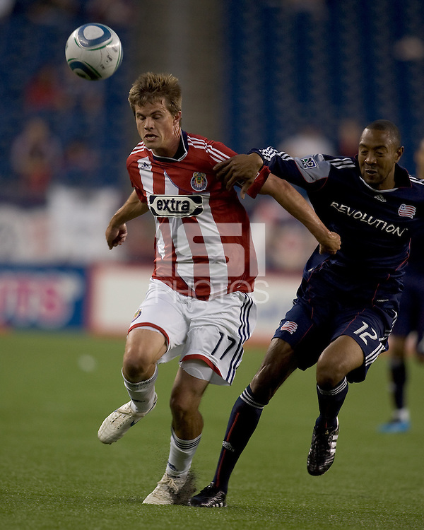 Chivas USA forward Justin Braun (17) heads the ball as New England Revolution defender Cory Gibbs (12) defends. Chivas USA defeated the New England Revolution, 4-0, at Gillette Stadium on May 5, 2010.