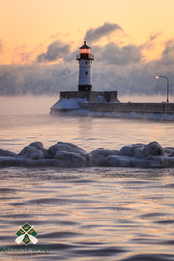 &quot;Sebzero Serenity&quot;<br /> The hope of sea smoke inspires us to visit Lake Superior on subzero mornings. Sea smoke (winter fog) is formed when the temperature of the open water is comparatively warmer than the subzero air temperature. Relatively calm conditions allow the evaporative cooling to form plume-like fog that gracefully glides across the lake to gather in low level cloud formations. This is another one of our favorite winter weather treasures!