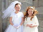 Sadhbh Price and Eve Latvis from Scoil Aonghusa who recieved first holy communion at St Peters church West street. Photo: Colin Bell/pressphotos.ie