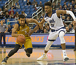 California Baptist guard Marquise Mosley (2) drives past Nevada's Jordan Brown (21) in the second half of an NCAA college basketball game in Reno, Nev., Monday, Nov. 19, 2018. (AP Photo/Tom R. Smedes)