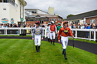 Jockeys enter the Parade Ring during Afternoon Racing at Salisbury Racecourse on 7th August 2017