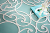 Abigail, a handmade mosaic shown in honed Aquaberyl Serenity glass and polished Calacatta, is part of the Parterre Collection by Paul Schatz for New Ravenna.