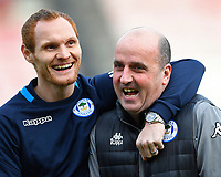 Ex AFC Bournemouth player Shaun MacDonald of Wigan Athletic left shares a joke with Wigan Athletic Manager Paul Cook  during AFC Bournemouth vs Wigan Athletic, Emirates FA Cup Football at the Vitality Stadium on 6th January 2018