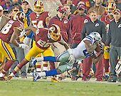Dallas Cowboys wide receiver Dez Bryant (88) catches the ball near the sideline late in the fourth quarter against the Washington Redskins at FedEx Field in Landover, Maryland on Monday, December 7, 2015.  After review he was ruled out-of-bounds by the officials.  Washington Redskins cornerback Bashaud Breeland (26) and free safety Dashon Goldson (38) defend on the play.  The Cowboys won the game 19-16.<br /> Credit: Ron Sachs / CNP