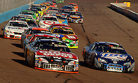 Nov 13, 2005; Phoenix, Ariz, USA;  Nascar Nextel Cup drivers Carl Edwards and Rusty Wallace lead a pack of cars during the Checker Auto Parts 500 at Phoenix International Raceway. Mandatory Credit: Photo By Mark J. Rebilas