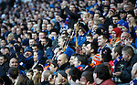 Lawrie entertaining the fans with Rangers tunes on the bagpipes