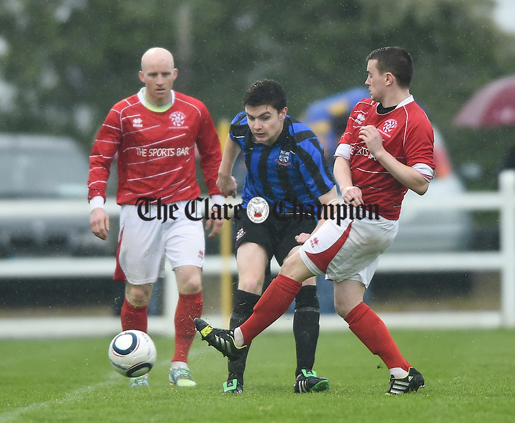 Darragh Fitzgerald of Bridge United in action against Darren Cullinan of Newmarket Celtic during their Cup final at Doora. Photograph by John Kelly.