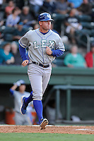 Coach Justin Gemoll of the Lexington Legends in a game against the Greenville Drive on Friday, August 16, 2013, at Fluor Field at the West End in Greenville, South Carolina. (Tom Priddy/Four Seam Images)