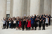 People raise their fists as they depart the Supreme Court after hearing arguments on the Deferred Action for Childhood Arrivals program in Washington D.C., U.S. on Tuesday, November 12, 2019.<br /> <br /> Credit: Stefani Reynolds / CNP