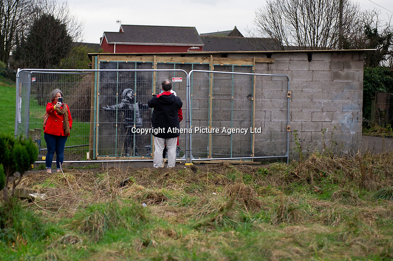 Pictured: The Banksy graffiti on a garage in Port Talbot, Wales, UK. Friday 11 January 2019<br /> Re: A Banksy artwork, on the side of a garage in Port Talbot in December, has been sold privately for a six-figure sum.<br /> Season's Greetings was sold to Essex-based gallery owner John Brandler, who said he will keep the graffiti work in the town for a minimum of 2-3 years.<br /> About 20,000 people are thought to have visited the artwork in the past month.<br /> Steelworker Ian Lewis, who originally owned the artwork, said the sale was a weight off his shoulders.