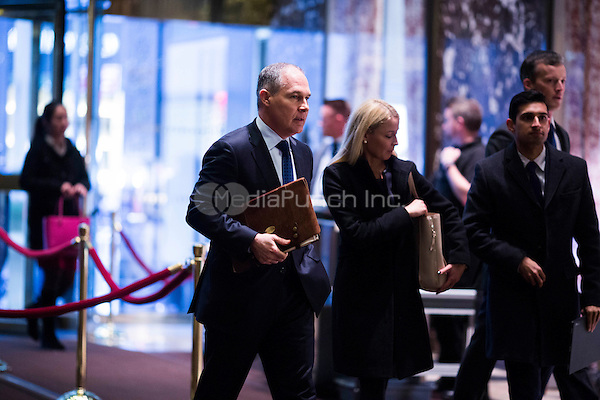 Attorney General Scott Pruitt (Republican of Oklahoma), left, arrives at Trump Tower in Manhattan, New York, USA, on Wednesday, December 7, 2016. <br /> Credit: John Taggart / Pool via CNP /MediaPunch